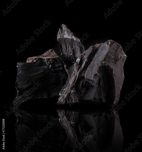 Coal lumps on dark background - 77320008