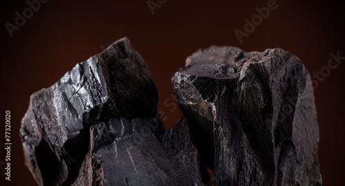 Coal lumps on dark background - 77320020