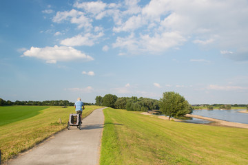 Man on bike near river
