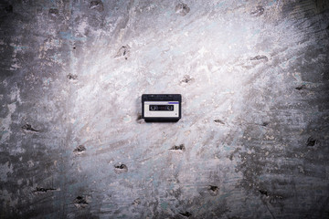 audio tape cassette on a concrete background