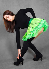 Portrait of a young attractive woman in a bright green skirt