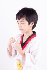 little boy in a Taekwondo suit