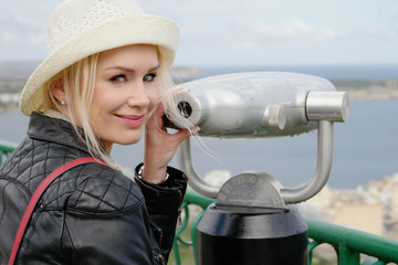 Pretty Smiling Woman Posing at the Telescope