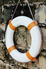 Close up Lifebuoy Hanging on Old Wall