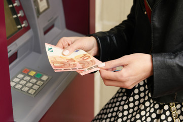 Woman Showing Withdrawn Money from the ATM