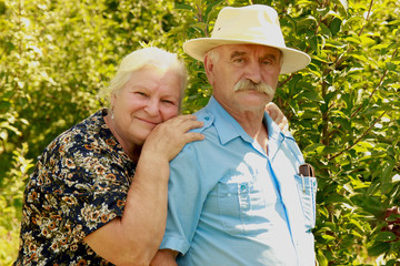 elderly couple on nature