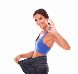 Dieting young woman gesturing ok sign