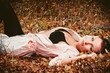 woman lying on the leaves