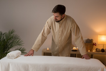 Masseur at spa or beauty salon working