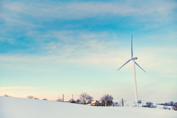 Wind turbines on winter field