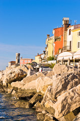 Colorful architecture at harbor of Piran, coastal town in Istria