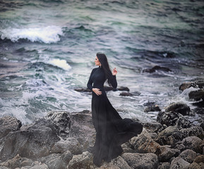 Woman in Long Dress at Stormy Sea