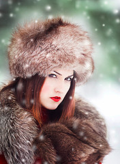 Beautiful and sexy woman in snowy winter outdoors