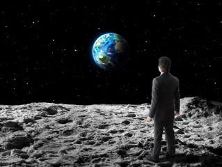 businessman walks  on moon surface