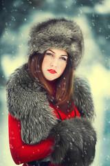 Beautiful  woman in snowy winter outdoors