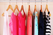 Female clothes on hangers in wardrobe - 77333857