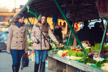 Two young women on farmer's market