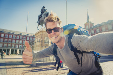 student backpacker tourist taking selfie photo with mobile phone