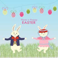 The two rabbits dance on the grass for easter celebration