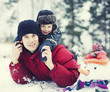 portrait of happy father with his son outside with snowman close