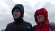 Adult Couple Resist Hurricane Winds, closeup