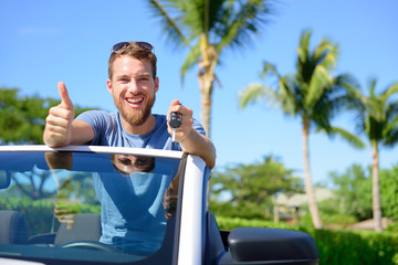 Car driver showing keys and thumbs up happy