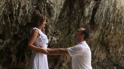 groom embraces bride round her waist