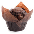 Chocolate chip muffin in brown wax paper. - 77356217
