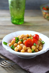 Delicious salad with boiled chickpeas and tomatoes