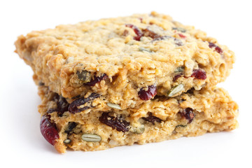 Homemade luxury fruit muesli bar. On white.