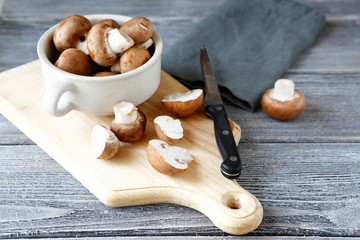 Mushrooms and knife on  cutting board