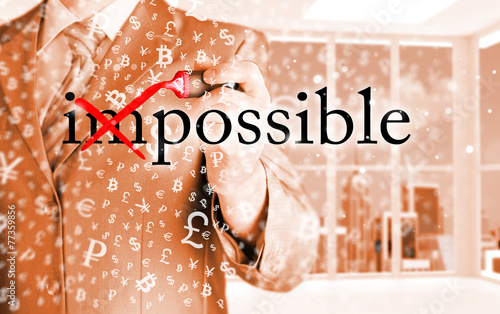 canvas print picture Businessman Hand turning the word Impossible into Possible with