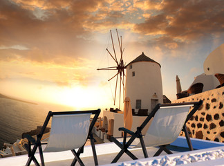 Windmill against colorful sunset, Santorini, Greece