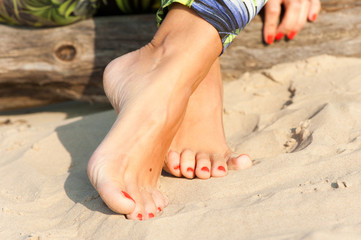 Tidy tanned sexual soft woman feet. Summertime outdoors close-up