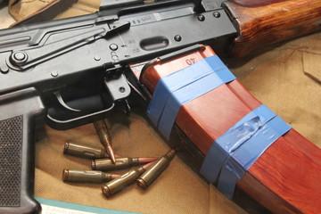 Kalashnikov rifle with ammunition on the desk