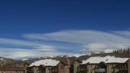 Time lapse clip of mountain ski town condos in winter