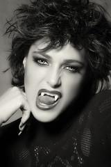 Female vampire baring her fangs. Monochrome Beauty Fashion Portr