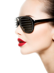 Fashion profile portrait of  woman wearing black sunglasses