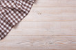 Top view of checkered tablecloth on white wooden table. - 77366058