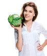Good looking woman holding a head of cabbage in her hand