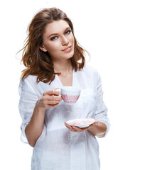 Beautiful woman holding a cup of coffee and saucer