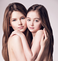 Beautiful naked mother and small daughter 8 years with long bro