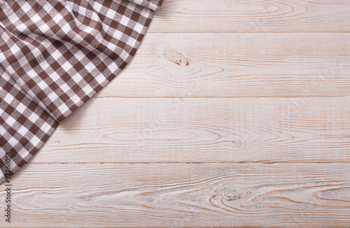 Foto op Aluminium Boord Top view of checkered tablecloth on white wooden table.