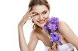 Young beautiful smiling woman with blue-violet iris flower