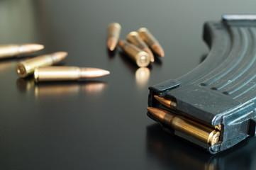 Kalashnikov bullets on the table.