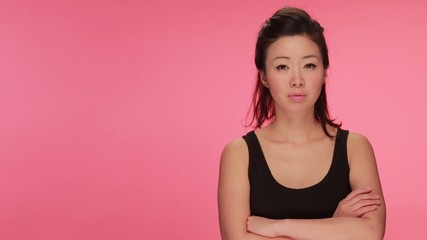 Young Asian woman serious face portrait