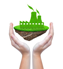 Small island with green nuclear power plant icon in hands