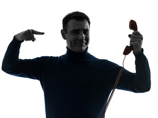 man showing telephone silhouette portrait