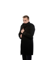 Young man in a coat. Distrust in oneself context.
