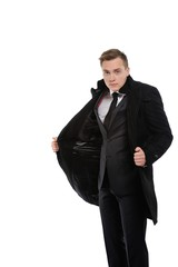 Young businessman showing under his coat.
